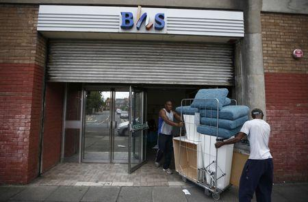 Workers remove items from the Wood Green branch of department store chain BHS, after its final closure, in London, Britain August 28, 2016.  REUTERS/Peter Nicholls