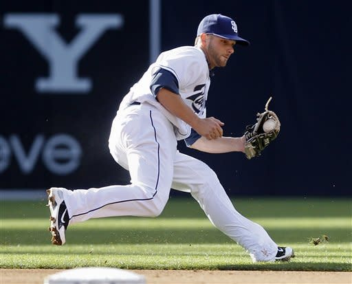 San Diego Padres shortstop Andy Parrino goes behind second base to haul in a sharp ground ball hit by Arizona Diamondbacks' Aaron Hill in the fifth inning of a baseball game on Wednesday, April 11, 2012 in San Diego. (AP Photo/Lenny Ignelzi)