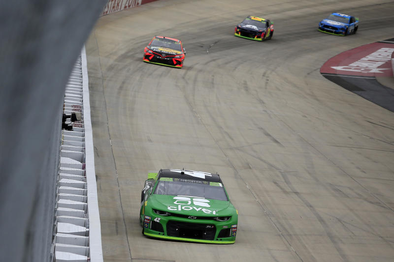 DOVER, DELAWARE - OCTOBER 06: Kyle Larson, driver of the #42 Clover Chevrolet, leads a pack of cars during the Monster Energy NASCAR Cup Series Drydene 400 at Dover International Speedway on October 06, 2019 in Dover, Delaware. (Photo by Chris Trotman/Getty Images)