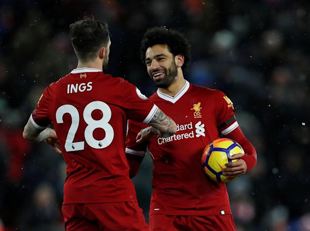 "Soccer Football - Premier League - Liverpool vs Watford - Anfield, Liverpool, Britain - March 17, 2018 Liverpool's Mohamed Salah celebrates with the match ball and Danny Ings after the match Action Images via Reuters/Lee Smith EDITORIAL USE ONLY. No use with unauthorized audio, video, data, fixture lists, club/league logos or ""live"" services. Online in-match use limited to 75 images, no video emulation. No use in betting, games or single club/league/player publications. Please contact your account representative for further details."