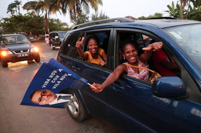 Supporters of presidential candidate Vila Nova celebrate the provisional results of the presidential elections in Sao Tome, Sao Tome and Principe.