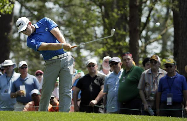 Hunter Mahan tees off on the fourth hole during the third round of the Masters golf tournament Saturday, April 12, 2014, in Augusta, Ga. (AP Photo/Chris Carlson)