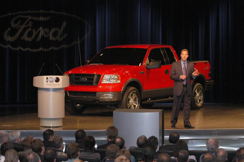 2003 Ford Employee Meeting Ford World Headquarters. Bill Ford speaking to employee group with F150 on stage.