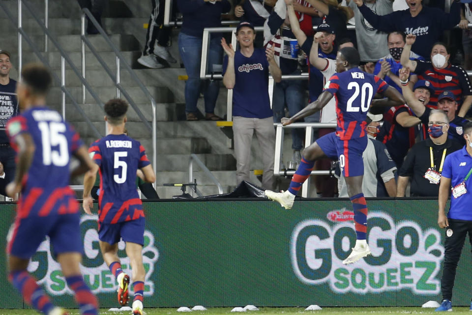 United States' Tim Weah, right, celebrates his goal against Costa Rica during the second half of a World Cup qualifying soccer match Wednesday, Oct. 13, 2021, in Columbus, Ohio. The United States won 2-1. (AP Photo/Jay LaPrete)