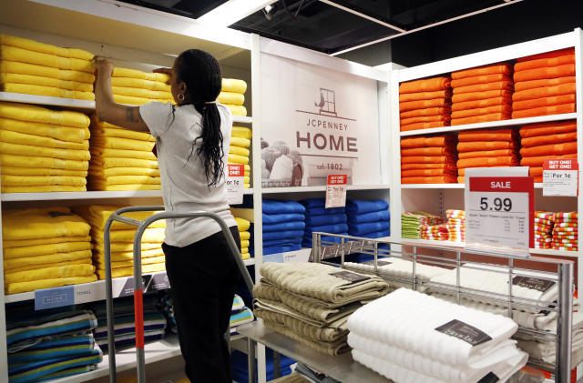 In this March 10, 2016 photo, a sales clerk arranges towels at a J.C. Penney store, in New York. (AP Photo/Mark Lennihan)