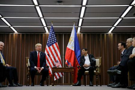 U.S. President Donald Trump holds a bilateral meeting with President of the Philippines Rodrigo Duterte alongside the ASEAN Summit in Manila, Philippines November 13, 2017. REUTERS/Jonathan Ernst