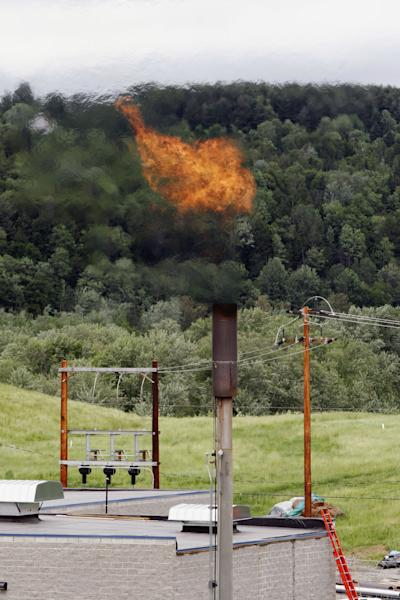 FILE - In this June 15, 2005 file photo, methane gas from a landfill burns off a stack near the Washington Electric Cooperative power plant in Coventry, Vt. Establishing a New England market to buy renewable energy seemed a laudable goal when governors committed last year to bulk purchases of wind and solar power to cut the price of alternative energy while reducing the region's reliance on fossil fuels. But putting together details about what the six states will buy is snared in a patchwork of rules, state laws and disagreements among the states over how to even define alternative energy. (AP Photo/Toby Talbot, File)