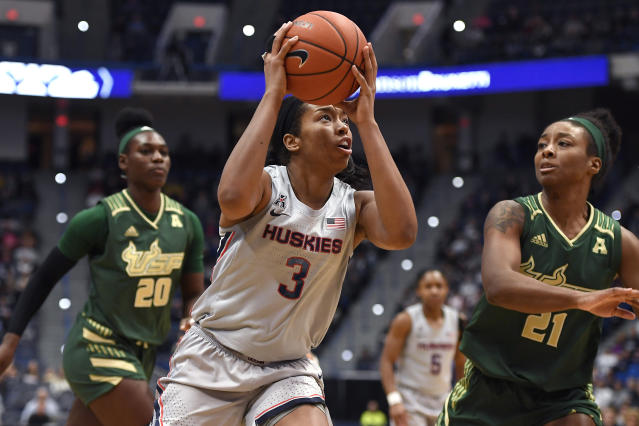 Connecticut's Megan Walker (3) looks to shoot as South Florida's Shae Leverett (21) defends in the first half of an NCAA college basketball game, Monday, March 2, 2020, in Hartford, Conn. (AP Photo/Jessica Hill)