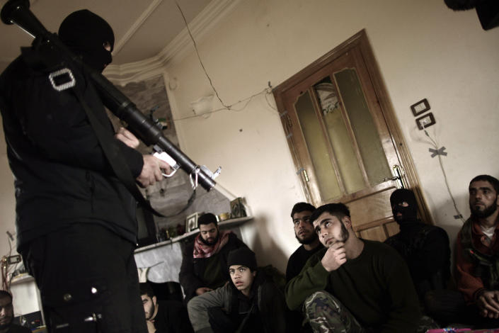 FILE - In this Monday, Dec. 17, 2012 file photo, Syrian rebels listen to their trainer on how to use a rocket propelled grenade in Maaret Ikhwan, near Idlib, Syria. America's Arab allies have dramatically stepped up weapon supplies to Syrian rebels in preparation for a push on the capital Damascus, the main stronghold of President Bashar Assad, officials and Western military experts say, with one official saying airlifts to neighboring Jordan and Turkey have doubled the past month. The U.S. and other Western governments are involved to channel the flow toward more secular fighters, they say. The influx appears to be boosting a rebel drive to seize supply routes from the border with Jordan to Damascus. (AP Photo/Muhammed Muheisen, File)