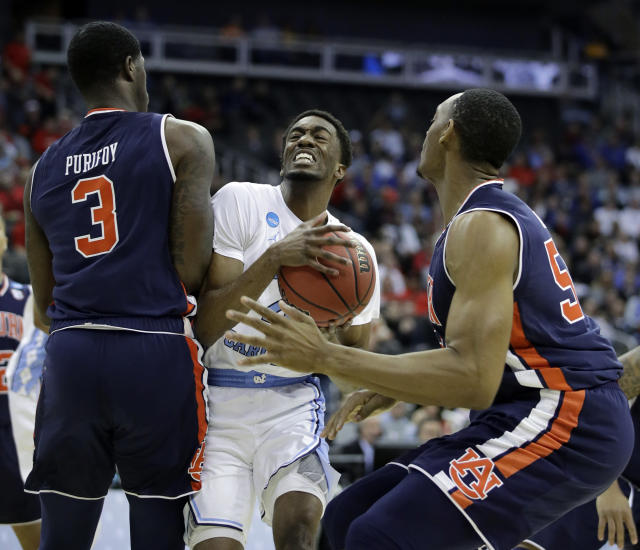 <p>North Carolina's Brandon Robinson, center, heads to the basket past Auburn's Danjel Purifoy (3) and Austin Wiley, right, during the first half of a men's NCAA tournament college basketball Midwest Regional semifinal game Friday, March 29, 2019, in Kansas City, Mo. (AP Photo/Charlie Riedel) </p>