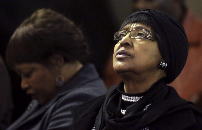 <p>Winnie Madikizela-Mandela, right, ex-wife of former South African President Nelson Mandela, and her daughter Zindzi attend a prayer service for the ailing Mandela at a church in Johannesburg, July 5, 2013. (Photo: Siphiwe Sibeko/Reuters) </p>