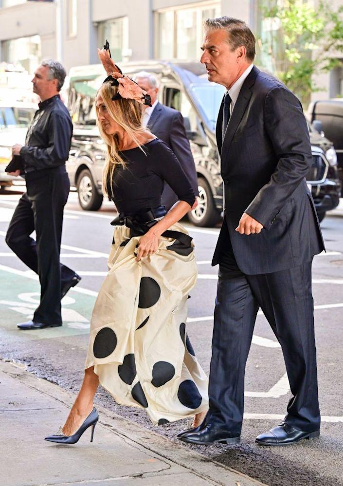 <p>SJP's Carrie Bradshaw wears an ornate headpiece and embellished heels with her dotted look, as Mr. Big wears a dark suit and tie. </p>