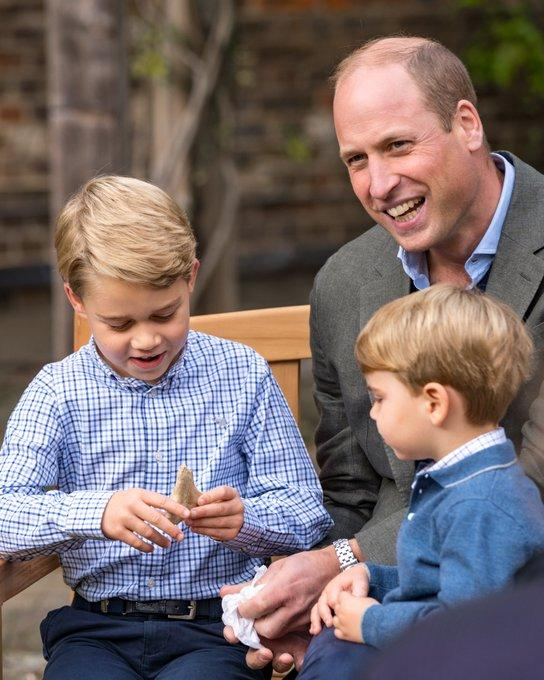 Prince George looks at shark tooth gift from Sir David Attenborough prince William and Prince Louis watch
