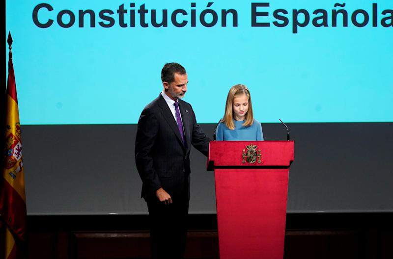 Spain's Princess Leonor reads part of Spain's Constitution as her father King Felipe looks on at the Cervantes Institute marking her first public speech in Madrid, Spain, October 31, 2018. REUTERS/Juan Medina