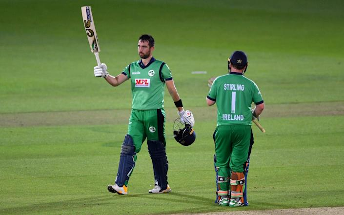Ireland's captain Andy Balbirnie celebrates his half century with Paul Stirling - REUTERS