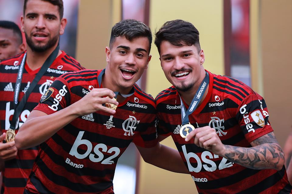 LIMA, PERU - NOVEMBER 23: Reinier Jesus #19 and Matheus Soares #26 of Flamengo celebrates the victory after winning the final match of Copa CONMEBOL Libertadores 2019 between Flamengo and River Plate at Estadio Monumental on November 23, 2019 in Lima, Peru. (Photo by Manuel Velasquez/Getty Images)