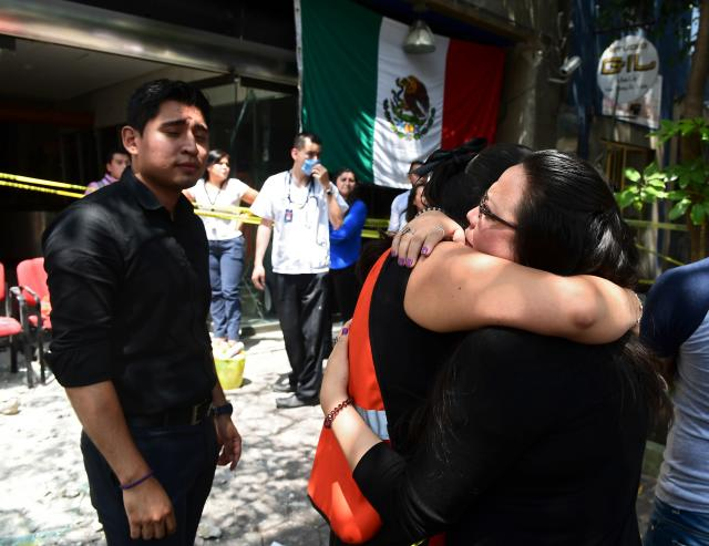 <p>People react after a quake rattled Mexico City on September 19, 2017.<br> A powerful earthquake shook Mexico City on Tuesday, causing panic among the megalopolis' 20 million inhabitants on the 32nd anniversary of a devastating 1985 quake. The US Geological Survey put the quake's magnitude at 7.1 while Mexico's Seismological Institute said it measured 6.8 on its scale. The institute said the quake's epicenter was seven kilometers west of Chiautla de Tapia, in the neighboring state of Puebla.<br> (Photo: Ronaldo Schemidt/AFP/Getty Images) </p>