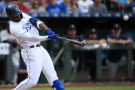 Kansas City Royals designated hitter Jorge Soler hits a solo home run off Minnesota Twins starting pitcher Martin Perez during the first inning of a baseball game at Kauffman Stadium in Kansas City, Mo., Sunday, Sept. 29, 2019. (AP Photo/Orlin Wagner)