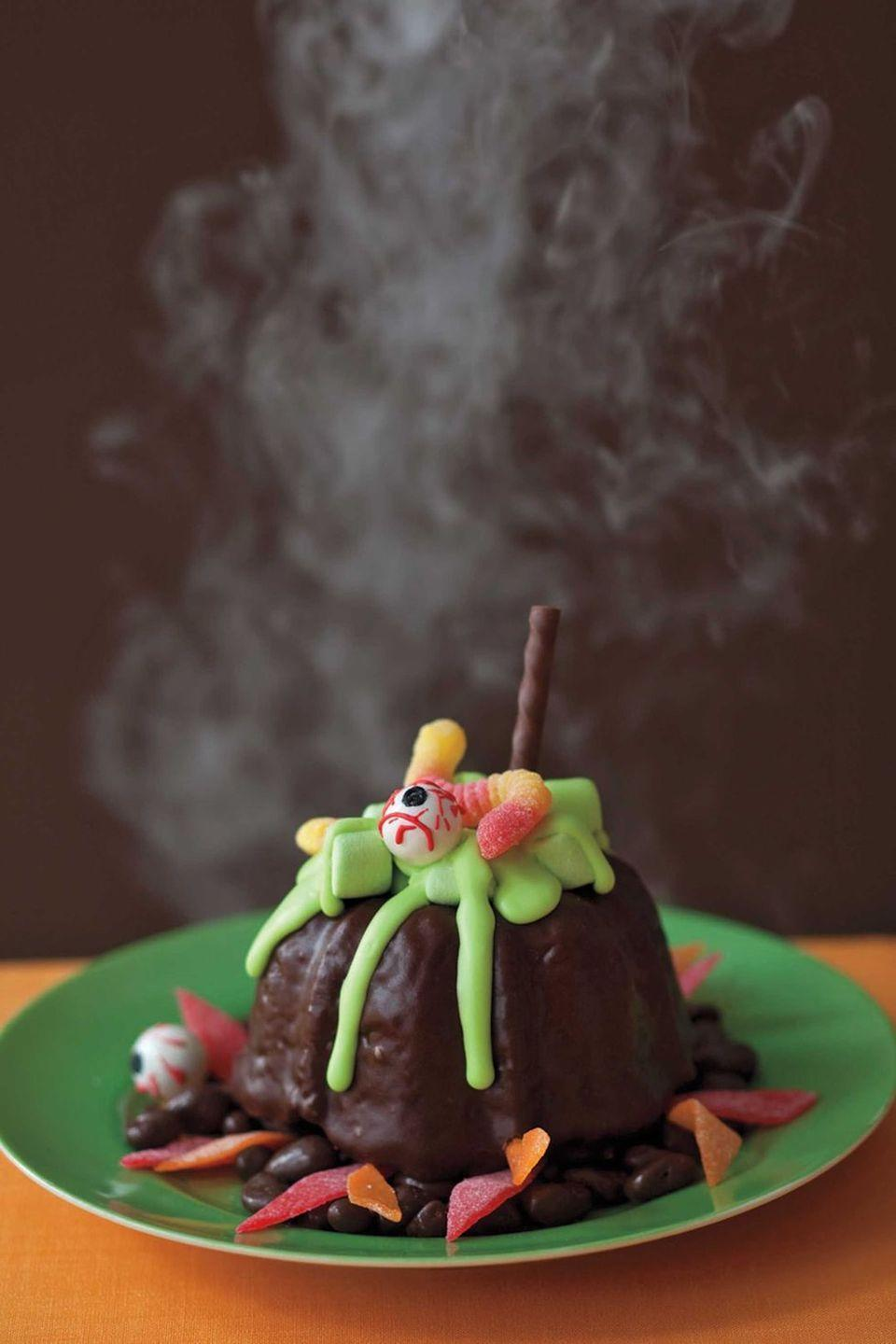 """<p>This fun take on a classic chocolate lava cake is sure to wow. Oozing with green frosting instead of a chocolate ganache, these desserts are guaranteed to scare, wow, and satisfy.</p><p><em><a href=""""https://www.womansday.com/food-recipes/food-drinks/recipes/a11039/mini-cauldrons-recipe-122469/"""" rel=""""nofollow noopener"""" target=""""_blank"""" data-ylk=""""slk:Get the recipe for Mini Cauldrons."""" class=""""link rapid-noclick-resp"""">Get the recipe for Mini Cauldrons. </a></em></p>"""