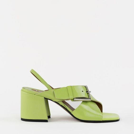 """<strong><a href=""""https://labucq.com/collections/shop-all/products/chan-lime-patent"""" target=""""_blank"""" rel=""""noopener noreferrer"""">Get the Labucq Chan sandals in lime patent leather for $355.</a></strong>"""