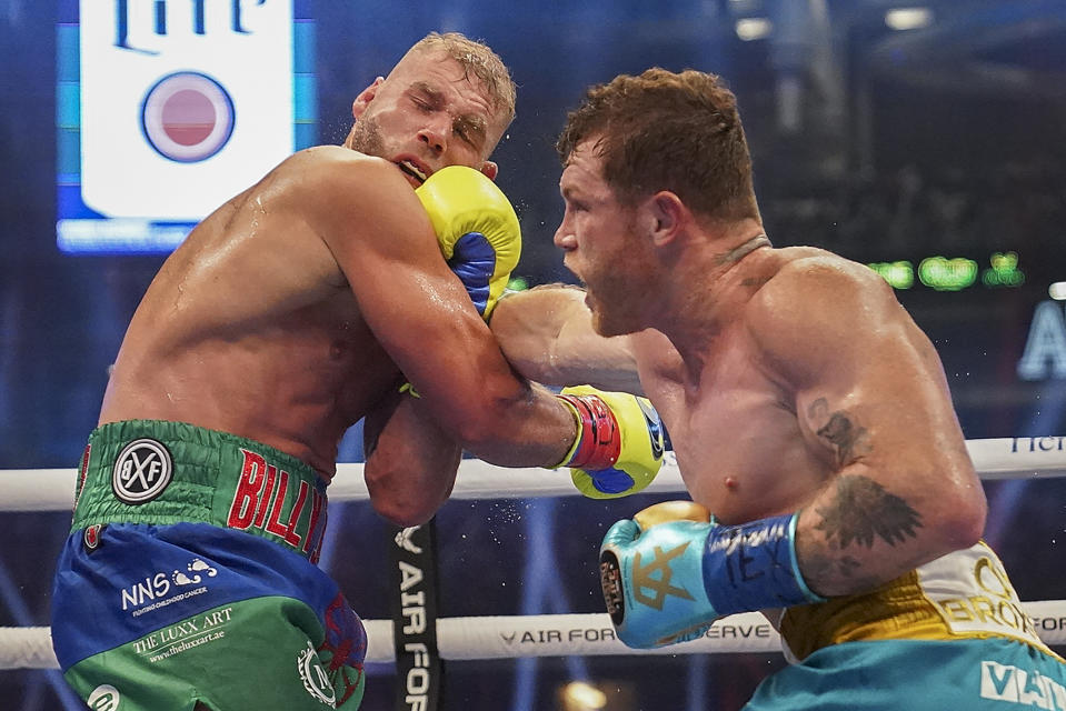 Canelo Alvarez, right, connects against Billy Joe Saunders during a unified super middleweight world championship boxing match, Saturday, May 8, 2021, in Arlington, Texas.(AP Photo/Jeffrey McWhorter)