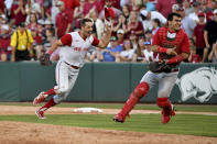 North Carolina State's Austin Murr (12) and Luca Tresh (24) celebrate after making the final out to beat Arkansas 3-2 to advance to the College World Series during an NCAA college baseball super regional game Sunday, June 13, 2021, in Fayetteville, Ark. (AP Photo/Michael Woods)