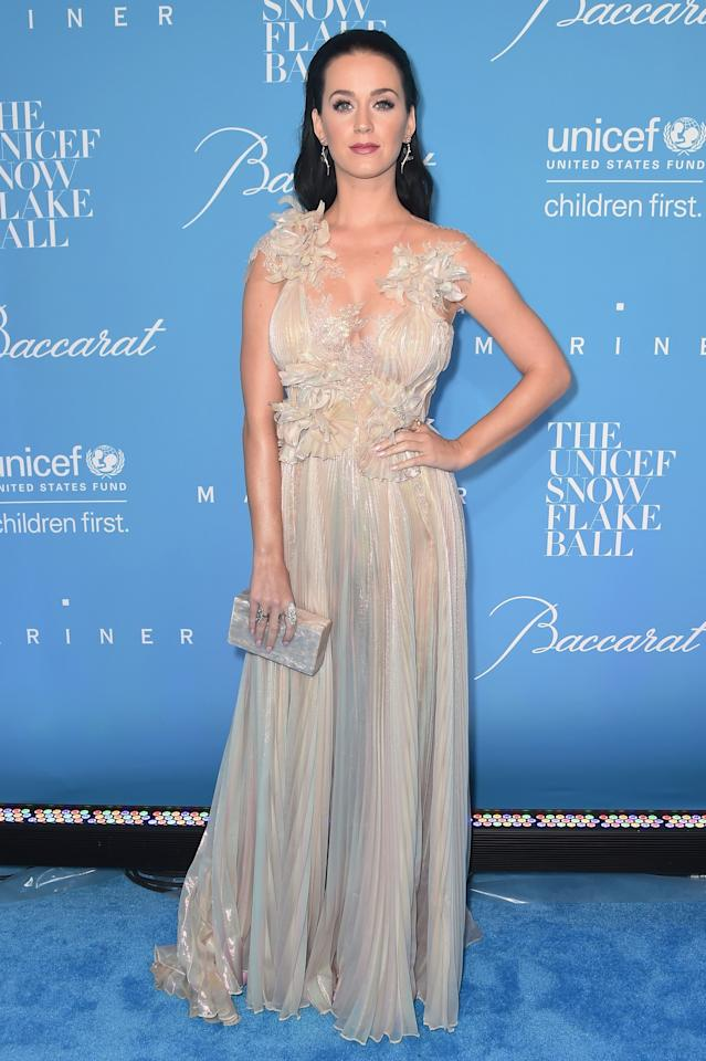 <p>Katy donned a champagne-hued Marchesa gown full of delicate floral ruffles for the winter ball. <i>[Photo: Getty]</i> </p>