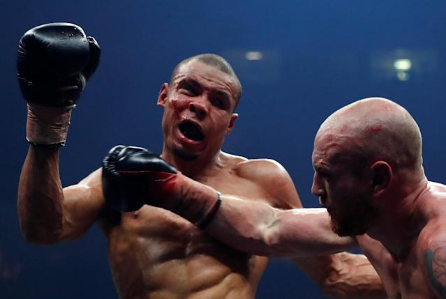 Boxing - World Boxing Super Series Semi Final - George Groves vs Chris Eubank Jr - WBA & IBO World Super-Middleweight Titles - Manchester Arena, Manchester, Britain - February 17, 2018 Chris Eubank Jr in action with George Groves Action Images via Reuters/Andrew Couldridge