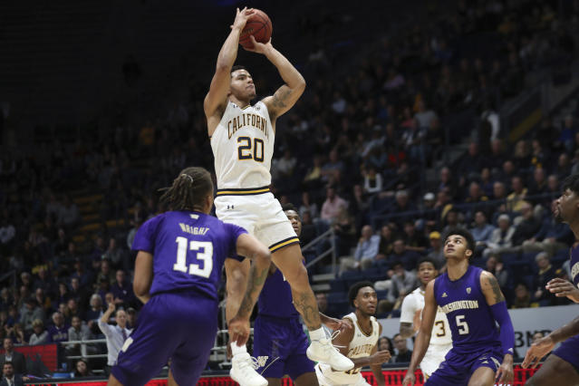 California guard Matt Bradley (20) shoots over Washington guard Hameir Wright (13) during the second half of an NCAA college basketball game in Berkeley, Calif., Saturday, Jan. 11, 2020. (AP Photo/Jed Jacobsohn)