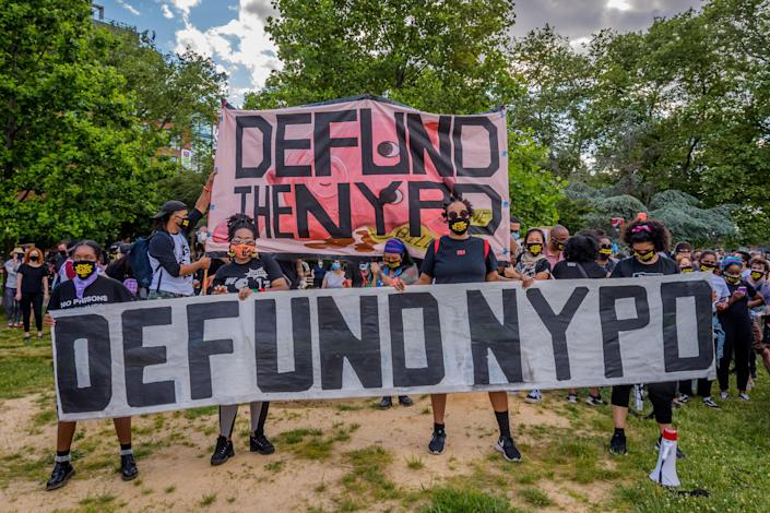 Participants holding a giant Defund NYPD banner. Thousands of protesters gathered at Mc Carren Park in Brooklyn for a massive march around Williamsburg, making a loud call for the defunding of the police force.(Erik McGregor/LightRocket via Getty Images)