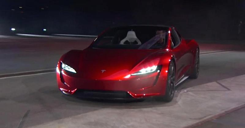 tesla ceo elon musk unveils a surprise new car a ridiculously fast roadster. Black Bedroom Furniture Sets. Home Design Ideas
