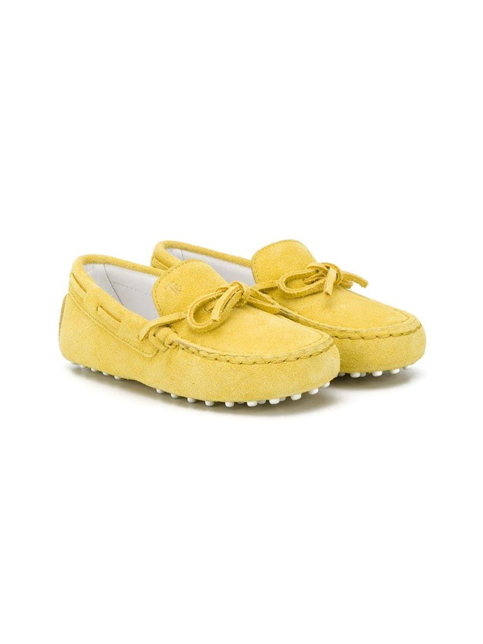 """<p><strong>Tod's Kids</strong></p><p>farfetch.com</p><p><strong>$236.00</strong></p><p><a href=""""https://go.redirectingat.com?id=74968X1596630&url=https%3A%2F%2Fwww.farfetch.com%2Fshopping%2Fkids%2Ftods-kids-bow-detail-loafers-item-15445368.aspx&sref=https%3A%2F%2Fwww.redbookmag.com%2Flife%2Fg34824699%2Fkids-gift-guide%2F"""" rel=""""nofollow noopener"""" target=""""_blank"""" data-ylk=""""slk:Shop Now"""" class=""""link rapid-noclick-resp"""">Shop Now</a></p><p>Driving loafers don't require a license. </p>"""
