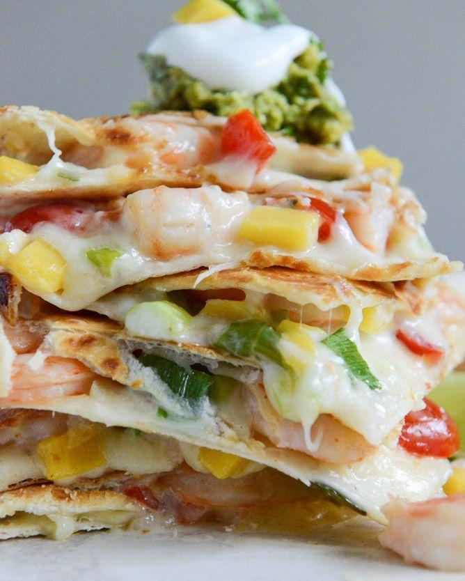 "<p>Seafood, beer, and quesadillas — what else could your watch party need? Oh yeah, spicy guac. There's some of that in here, too.</p><p><a href=""http://www.howsweeteats.com/2013/07/chipotle-beer-shrimp-quesadillas-with-spicy-guac/"" rel=""nofollow noopener"" target=""_blank"" data-ylk=""slk:Get the recipe from How Sweet It Is »"" class=""link rapid-noclick-resp""><em>Get the recipe from How Sweet It Is »</em></a></p>"