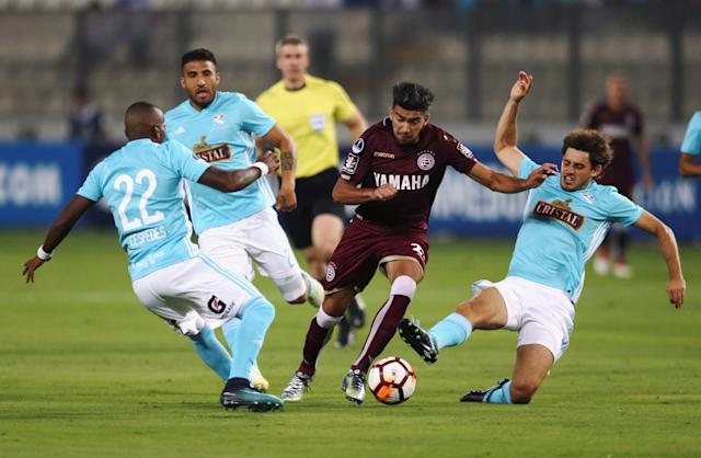 Soccer Football - Peru's Sporting Cristal v Argentina's Lanus - Copa Sudamericana - Nacional Stadium, Lima, Peru - March 7, 2018. Jair Cespedes, Josepmir Ballon and Omar Merlo of Sporting Cristal fight for the ball against Marcelino Moreno of Lanus. REUTERS/Mariana Bazo