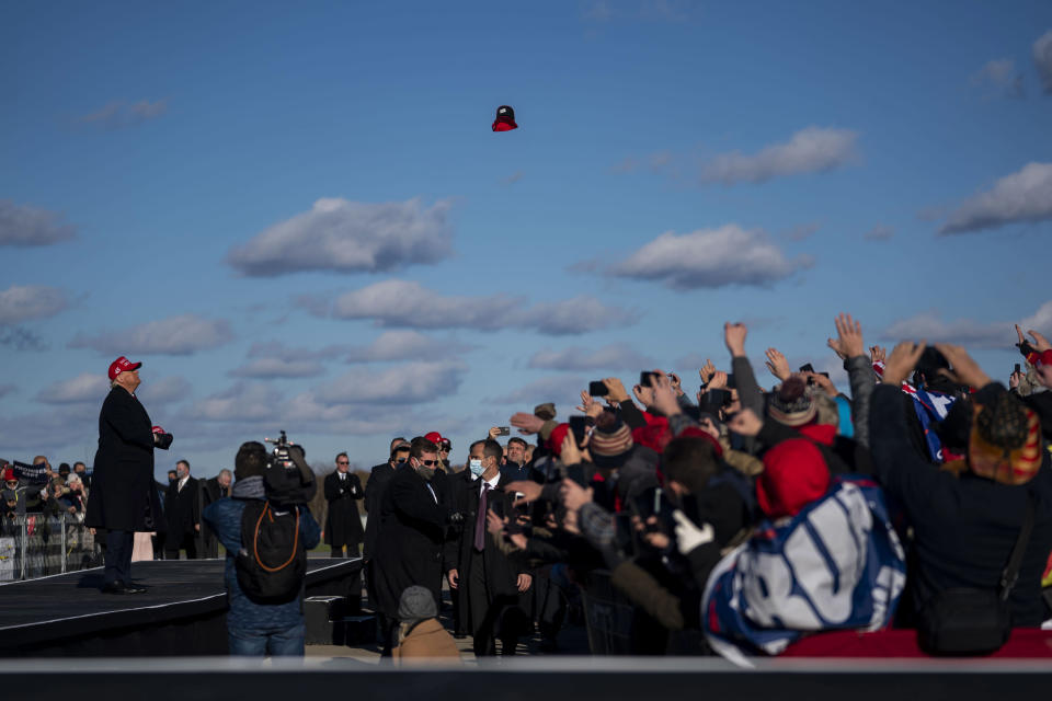Then-President Donald Trump throws campaign hats during a campaign event in Avoca, Penn., Nov. 2, 2020. (Doug Mills/The New York Times)
