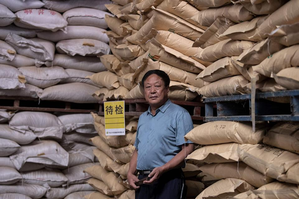 File: Chinese pig farmer and billionaire Sun Dawu posing at a feed warehouse in Hebei on 24 September, 2019 (AFP via Getty Images)