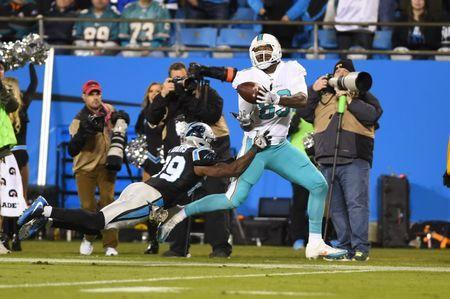 Nov 13, 2017; Charlotte, NC, USA; Carolina Panthers strong safety Mike Adams (29) breaks up a pass intended for Miami Dolphins tight end Julius Thomas (89) in the second quarter at Bank of America Stadium. Bob Donnan-USA TODAY Sports