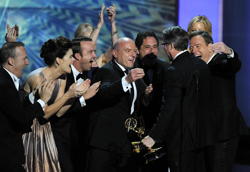 """FILE - This Sept. 22, 2013 file photo shows the cast of """"Breaking Bad,"""" from left, Bob Odenkirk, Betsy Brandt, Aaron Paul, Dean Norris and Bryan Cranston, right, congratulating creator Vince Gilligan, second right, after he accepted the award for outstanding drama series at the 65th Primetime Emmy Awards in Los Angeles. The Nielsen company said that on the same night that """"Breaking Bad"""" won an Emmy Award for best drama, the penultimate episode of that AMC series set a viewership record. An estimated 6.6 million people watched """"Breaking Bad"""" on Sunday, which was airing the same time the cast got its award. (Photo by Chris Pizzello/Invision/AP, File)"""