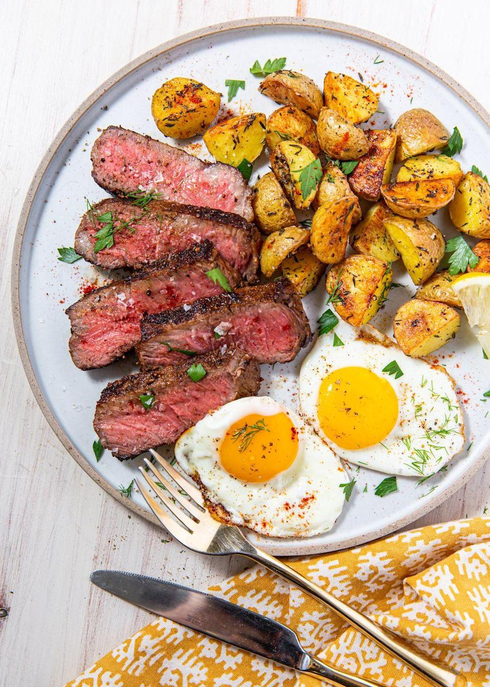 """<p>Our ideal brunch all year long. </p><p>Get the recipe from <a href=""""https://www.delish.com/cooking/recipe-ideas/a30433895/steak-and-eggs-recipe/"""" rel=""""nofollow noopener"""" target=""""_blank"""" data-ylk=""""slk:Delish"""" class=""""link rapid-noclick-resp"""">Delish</a>. </p>"""