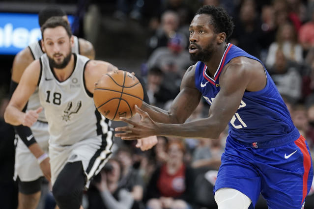 Los Angeles Clippers' Patrick Beverley, right, runs up the court during the first half of an NBA basketball game against the San Antonio Spurs, Saturday, Dec. 21, 2019, in San Antonio. (AP Photo/Darren Abate)