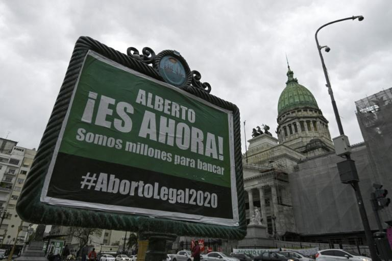 An advert asking President Alberto Fernandez to present a new bill to legalize abortion, pictured outside the Argentine Congress building in Buenos Aires, in October 2020