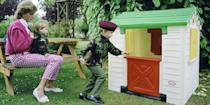 <p>Prince William and Prince Harry play with Princess Diana in their army uniforms at Highgrove House.</p>