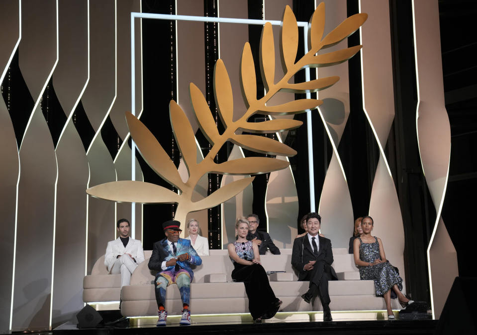 Jury members Tahar Rahim, from back left, Jessica Hausner, Kleber Mendonca Filho, Mylene Farmer, Spike Lee, from bottom left, Melanie Laurent, Song Kang-ho, and Mati Diop appear during the awards ceremony at the 74th international film festival, Cannes, southern France, Saturday, July 17, 2021. (AP Photo/Vadim Ghirda)