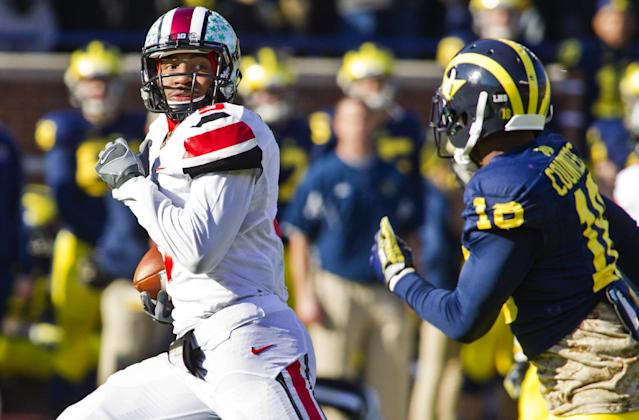 Ohio State quarterback Braxton Miller (5) looks back at Michigan defensive back Blake Countess (18) as he rushes for a touchdown in the first quarter of an NCAA college football game in Ann Arbor, Mich., Saturday, Nov. 30, 2013. (AP Photo/Tony Ding)