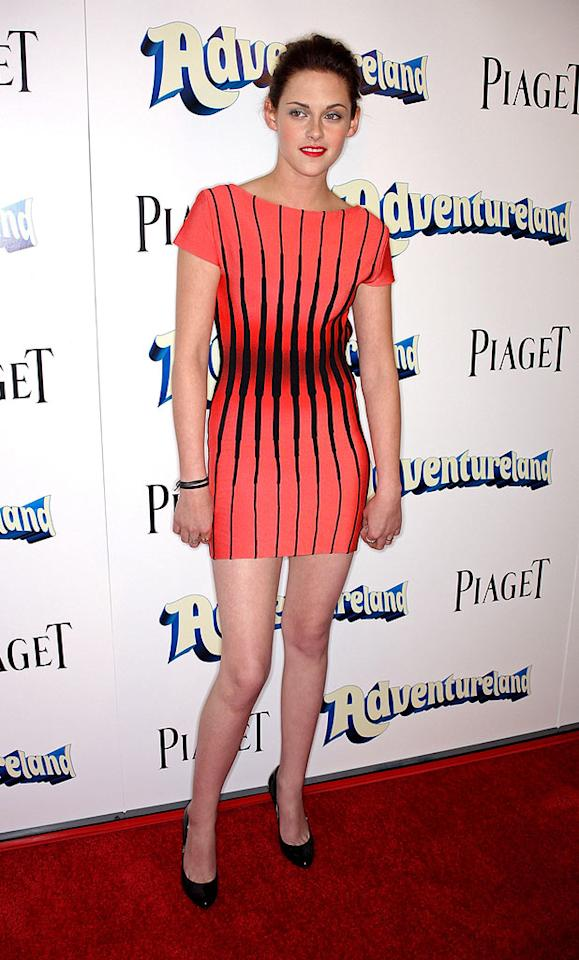 "Even ""Twilight's"" Kristen Stewart looks less than thrilled with her unsightly updo and bizarre black-and-coral bandage dress, courtesy of Herve Leger by Max Azria. Frederick M. Brown/<a href=""http://www.gettyimages.com/"" target=""new"">GettyImages.com</a> - March 16, 2009"