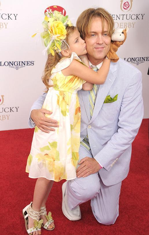 <p>As Dannielynn has grown older, her hair accessories have grown larger. In 2012, the pretty 5-year-old sported a floral look. Her headwear coordinated perfectly with her dress and sandals. (Photo: Michael Loccisano/Getty Images) </p>