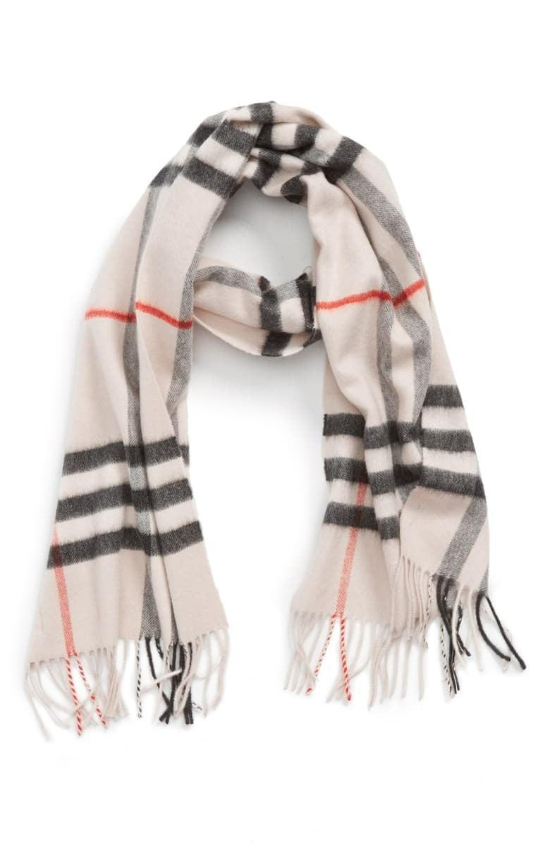 <p>One part sophisticated and one part cozy, the <span>Burberry Giant Icon Check Cashmere Scarf</span> ($470) is a Winter must have.</p>