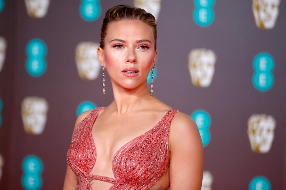 Scarlett Johansson looked pretty in blush pink on the BAFTA red carpet [Image: Getty]