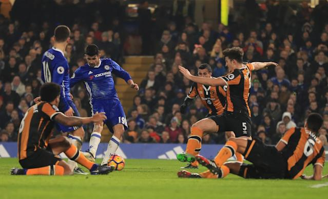 <p>Diego Costa does what he does best, and slides the ball beyond the Hull defence and into the net </p>