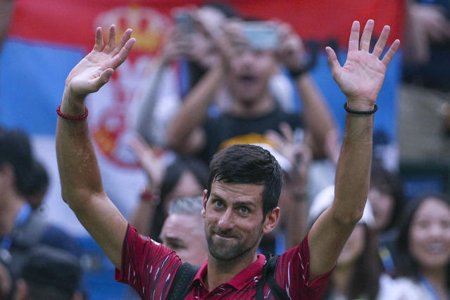 Novak Djokovic of Serbia waves to spectators as he leaves the court after he lost to Stefanos Tsitsipas of Greece in their men's singles quarterfinals match at the Shanghai Masters tennis tournament at Qizhong Forest Sports City Tennis Center in Shanghai, China, Friday, Oct. 11, 2019. (AP Photo/Andy Wong)